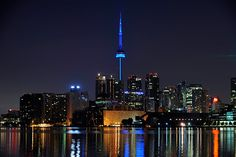 The CN Tower is illuminated in Toronto, Canada is illuminated blue