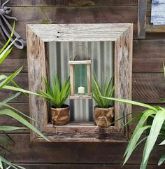 Antique #candle #lantern with 2 pot plants in #verticalgarden box measuring 70cm x 60cm x 10cm approximately. Handmade from #recycledtimber Comes complete for ......... $95 Click this link to go straight to our website to order www.newagerusticdesigns.com.au or  email newagerustic@gmail.com or  sms 0418-315-890