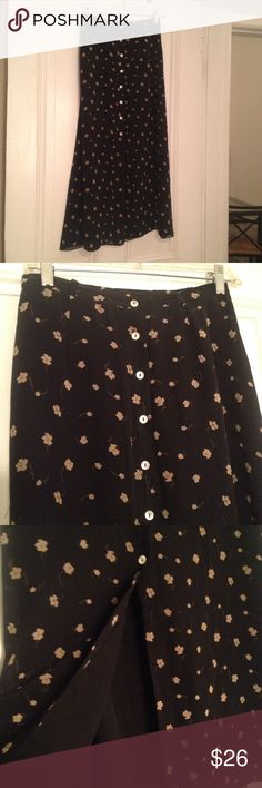 Black with floral print silk lined skirt Black with floral print silk lined skirt - button front. Ann Taylor Skirts