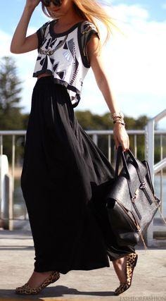 Black high-waist maxi, black & white print crop top, and a black bag.