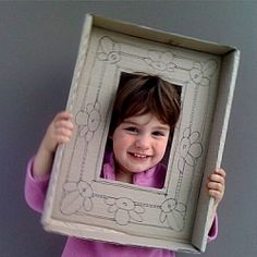 Upcycle a cardboard box lid to make a pretend picture frame as a quick photo-booth prop.  FUN!