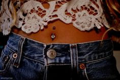 belly button jewelry, sexy lacy top, & denim shorts... it all works for me (jvb).