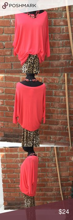 Coral Raglan Top MEDIUM This top has a Raglan sleeve very loose fitting and long can belt it Blouse over and still turn under or leave long. It's pops any outfit .  Check your Closet out and match in style. I bet you Do. You can even use a scarf as a shawl for those cooler evenings. Nice with SKINNY leggings 2 and goes great with long skirts and blue jeans Tops Blouses