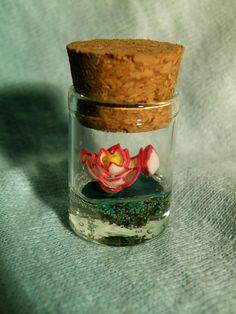 Lotus flower in Glass bottle Pendant by ThePurpleArtichoke7, €12.00