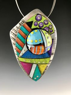 Prismacolor pencil on copper with Lampwork glass cab.