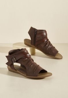 While packing for your Eastern European adventure, you gaze at these brown sandals from Blowfish and realize they're as important as your passport and camera. Stowing this faux-suede pair in your bag, you know their crisscross straps and micro wedges are a perfect fit for your 'Prague and roll' trip!