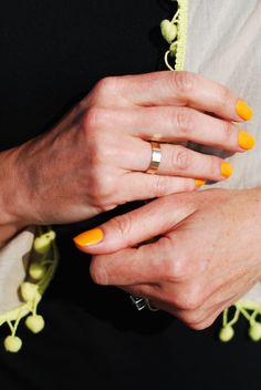 Neon orange nails and yellow pom poms - Not Dressed As Lamb