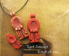 Tyet Amulet - The Knot of Auset -Protective Symbol - Handcrafted Pendant in Two Sizes and Finishes with Red Dye Oxide and Iron Rust Patina by shadowofthesphinx on Etsy https://www.etsy.com/listing/158453579/tyet-amulet-the-knot-of-auset-protective