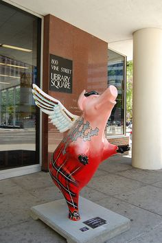 Flying high at the Cincinnati Main Library!  I love them because they clearly love a sassy pig :-)