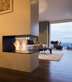 Feature bespoke double sided fireplace The Filaments Penthouse Collection Suna Interior Design Striking Three Bedroom Duplex Exuding a Vivid Personality in London