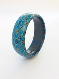 Unusual 'quilted' effect bangle, denim blues and oranges in a unique repeating pattern. Beautiful one-of-a-kind bracelet by DoodlePippin