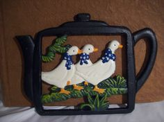 Painted cast iron trivet by TikTokArt on Etsy, $20.00
