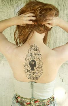 back tattoo - words and silhouette
