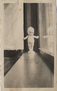 A Kewpie on the Window Sill - Small Vernacular Photograph (by Photo_History)