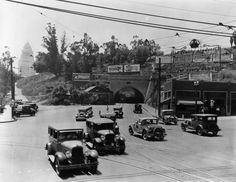 Traffic on Sunset Boulevard at the Broadway tunnel, with Los Angeles City Hall in the Background, 1929.