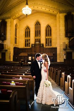 bride and groom with dramatic back light in the sanctuary of the First United Methodist Church in downtown Fort Worth, Texas.  Photo by http://tracyautem.com