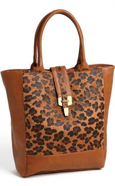 Add a fierce touch to your fall wardrobe with a Leopard Print Tote ( the inner lining is polka dots. So cute )
