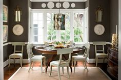 Use mixed finishes for a casual look. These painted chairs are paired with a round mahogany dining table. The mix of finishes on the room's various furnishings provides a collected, casual appeal.  See this 1920s Home Makeover
