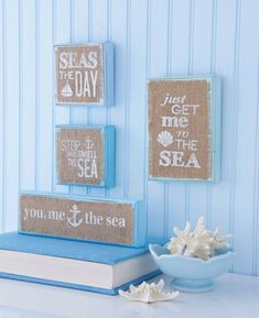 Seas the Day. Just Get Me to the Sea. Stop and Smell the Sea. You, Me, The Sea. Each phrase is printed on frayed edge burlap and affixed to a hand-painted wood frame. Beach sign may be hung on a wall or displayed on a tabletop.