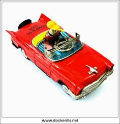 Bump'N Go Car, YOSHIYA, Japan. (Picture 2 of 3). Vintage Tin Litho Tin Plate Toy. Crank. Action - Mystery Action / Bump' N Go, driver moves and appears to be steering car. Photo in DOCKERILLS - TIN TOY REFERENCE - JAPAN - Google Photos