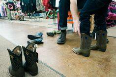trying on cowboy boots - Documentary Family Photography