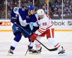 Maple Leafs vs. Red Wings - 01/01/2017 - Toronto Maple Leafs - Photos Matt Martin #15 of the Toronto Maple Leafs battles for position with Drew Miller #20