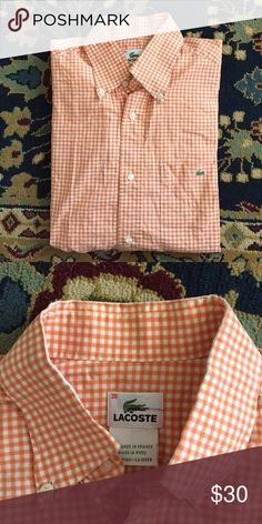 """Lacoste Gingham Button Down Men's Classic gingham I'm a modern color. Short sleeve for a causal look! In good used condition with some wear at color. It not visible once on. Tag reads 38 (S). 20.5"""" underarm to underarm and 28.5"""" L Lacoste Shirts Casual Button Down Shirts"""