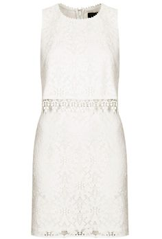 Brides.com: 37 Little White Dresses You Can Buy Right Now. Crop overlay wheel lace dress, $96, Topshop  See more lace wedding dresses.