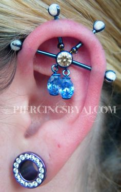i wish i was in new jersey so i could get pierced by this guy!!    Fresh 4 point custom industrial piercing with light blue titanium barbells, champagne cz center gem, white opal gems on the outside and arctic blue cz dangling gems. All jewelry from Industrial Strength. This piece placed 3rd in the 2011 Earmageddon contest held by Industrial Strength Body Jewelry.