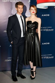 Emma Stone: Wears Lanvin black strapless leather dress at The Amazing Spider-man 2 premiere in Paris.