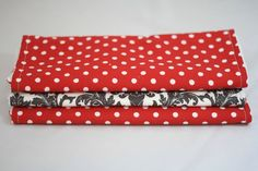 Set of three burp cloths, one charcoal grey damask and two red and white polka dot $15
