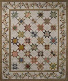 Select from 2 sizes and make a reproduction style quilt with an applique border. Includes complete instructions for machine piecing the stars and a full size applique border design. Star Quilts, Scrappy Quilts, Mini Quilts, Quilt Blocks, Antique Quilts, Vintage Quilts, Vintage Sewing, Quilting Projects, Quilting Designs