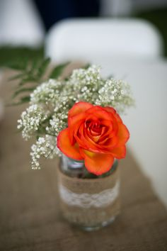 mason jar centerpiece - orange and white flowers with fern - burlap and lace accents