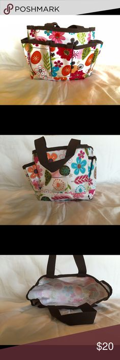 Thirty-One Bag This is a floral thirty-one bag. It has five small pockets on the front. It has been used once, and is in fabulous condition. Thirty-One Bags Totes