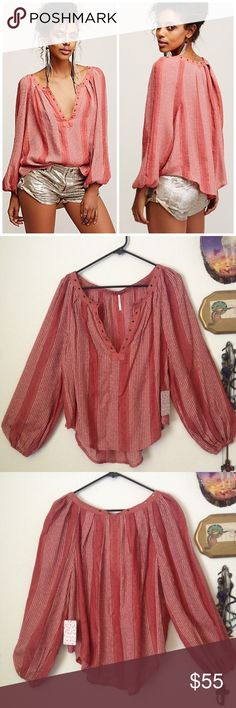 🆕Against all Odds striped oversize peasant top In an effortless, oversized fit this sheer blouse features metallic stripes, plunging V-neckline and metal grommet detailing. Long sleeves with elastic cuffs. Beautiful desert sun color. NWT. Size XS but could fit up to a medium. Free People Tops Blouses