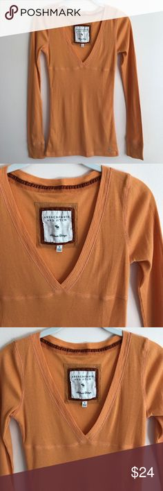 Abercrombie & Fitch orange ribbed tee Abercrombie & Fitch orange ribbed long sleeve fitted top - perfect condition never worn Abercrombie & Fitch Tops Tees - Long Sleeve
