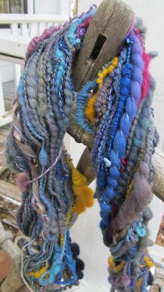 One of a kind skein of soft, luscious merino, mainly shades of blue with shots of yellow and fuschia 2 ply spiral spun on cotton thread 30 yards Thick And Thin, 2 Ply, Cotton Thread, Shades Of Blue, Merino Wool, All Things, Buy And Sell, Yellow, Purple