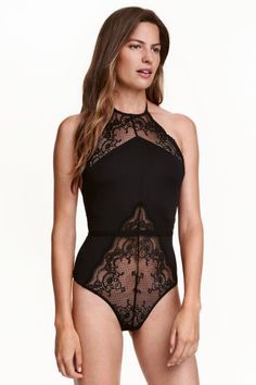 Microfibre and lace body: Halterneck body in microfibre with lace sections, a low-cut back with a tie at the back of the neck, elasticated seam at the waist and lined gusset with press-studs.