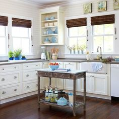 A cottage kitchen is always bright and cheery, frequently outfitted with crisp white cabinetry. Plain-front or Shaker-style doors keep the look clean and simple. Incorporate glass-front cabinets or open shelving to put dishes on display. Extra touches, such as a farmhouse sink or an old table repurposed as a kitchen island, add that personalized character indicative of cottage style./