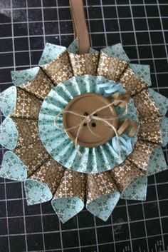 "Original pin called this an ornament (see the hanging ribbon?) Could also be used as a ""bow"" on a gift pkg. Paper Christmas Ornaments, Quilted Ornaments, Fabric Ornaments, Handmade Christmas, Christmas Fun, Christmas Decorations, Fabric Wreath, Christmas Print, Paper Rosettes"