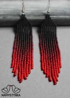 These red fringe earrings are made of high-quality Czech beads and strong synthetic thread. They are elegant, fashionable, and highly versatile, suitable for everyday wear. Features: Sterling silver components Color: red, brown, black. This item is currently in stock. You must be
