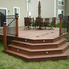I really like the metal railings with the composite decking. Such a nice look. And the in-step lighting is a great touch.