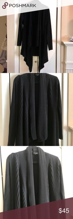 WHBM - Long Black Cascading High/Low Sweater Beautiful black sweater that cascades down the front   The back of the sweater is straight across and is higher than the front   Very good condition   May be hand washed or dry cleaned  Offers on everything in my closet are always welcome! White House Black Market Sweaters