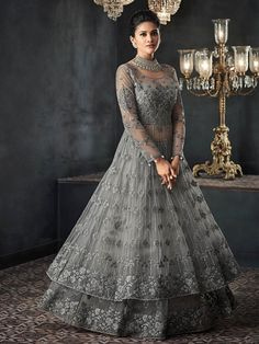Silver Grey Zari Embellished Party Wear Lehenga Anarkali Suit is specifically designed to make you look perfect as a bride and bridesmaids. This suit set features zardosi and resham kari thread emb. Indian Gowns Dresses, Pakistani Dresses, Indian Wedding Gowns, Flapper Dresses, Net Dresses, Desi Wedding, Gothic Wedding, Gown Wedding, Party Wear Lehenga