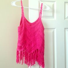 "Fringe Tank Beautiful pink fringe tank great for this summer! Stunning piece...no tag but is a M. 25"" Long excellent condition, its just been sitting in my closet so I figured I'd sell. Never worn, the 4th pic is not mine it's @ Scanon she's modeling a white in a size S. I'm selling the exact same only pink and a size M. *LF Inspired* LF Tops Tank Tops"