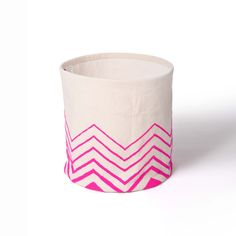These baskets are embroidered with bright pink acrylic wool on off white canvas which is sturdy to keep its shape. The inside of the basket is lined with off white cotton sheeting.