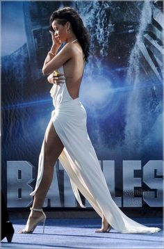 Rihanna in white. | concerttickets.com #style #rihanna #favoriteartists