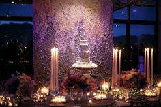 Ask your florist to create a backdrop of roses for a magical garden look at your wedding reception!