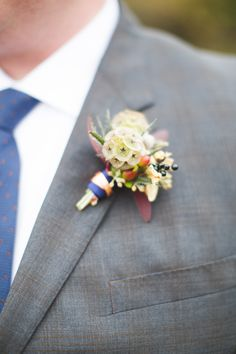 Scabiosa Pod Boutonniere | On Style Me Pretty: http://www.StyleMePretty.com/2014/02/27/the-barn-at-harvest-moon-pond-wedding/ Dani Stephenson Photography