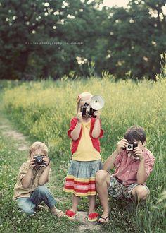Children with vintage cameras
